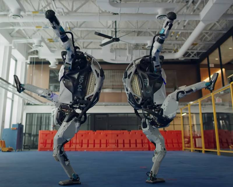 Shows two dancing Robots from Boston Dynamics.